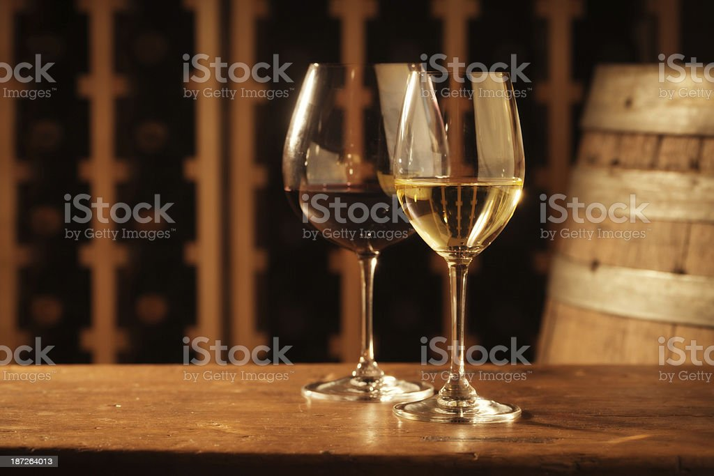 Red and White Wine Tasting Glasses by Cellar Racks, Barrel stock photo