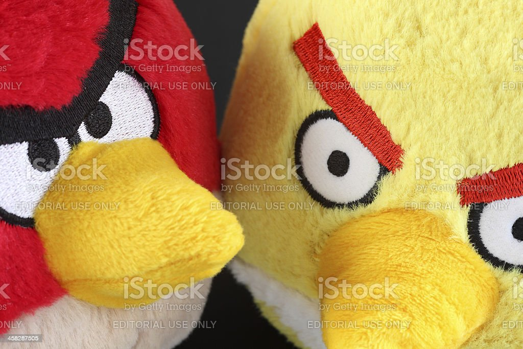 Red and Yellow Angry Birds soft toys royalty-free stock photo