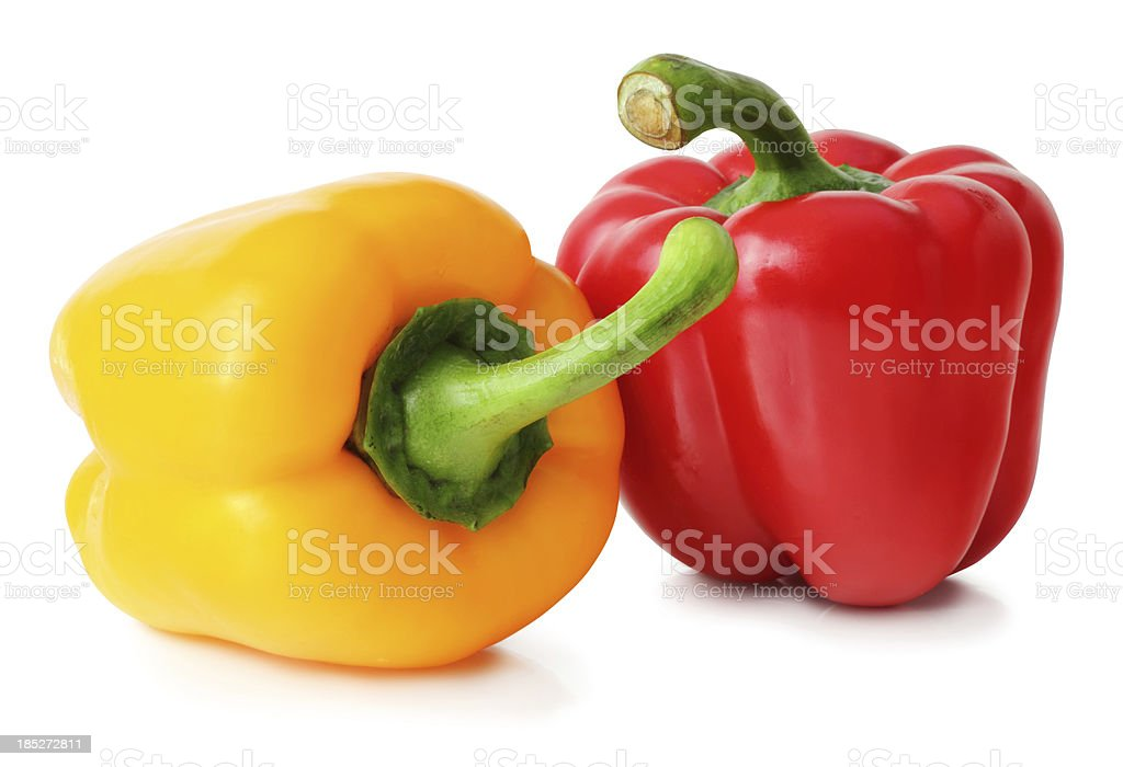 Red and yellow bell peppers on white background stock photo