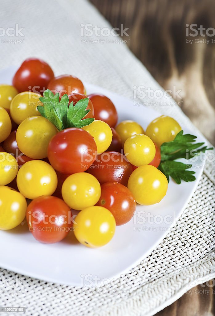 Red and yellow cherry tomatoes royalty-free stock photo