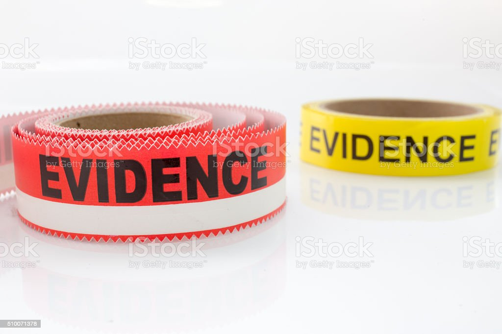 red and yellow evidence tape on white background stock photo