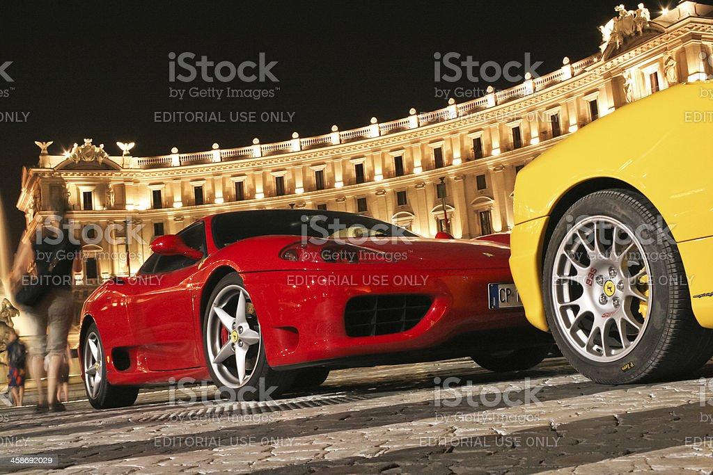 Red and yellow Ferrari cars at Piazza della Repubblica royalty-free stock photo