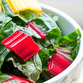 red and yellow leafy chard in a bowl