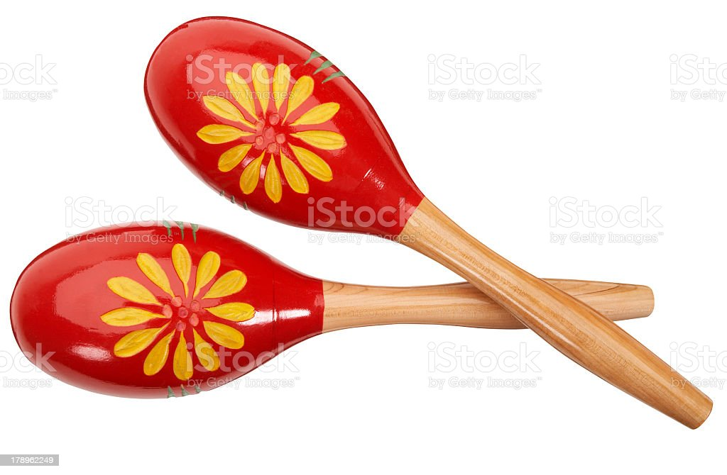 Red and yellow maracas on a white background stock photo
