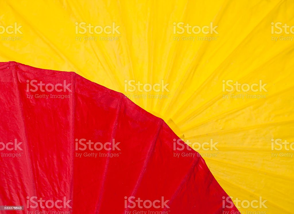 Red and yellow paper umbrella royalty-free stock photo