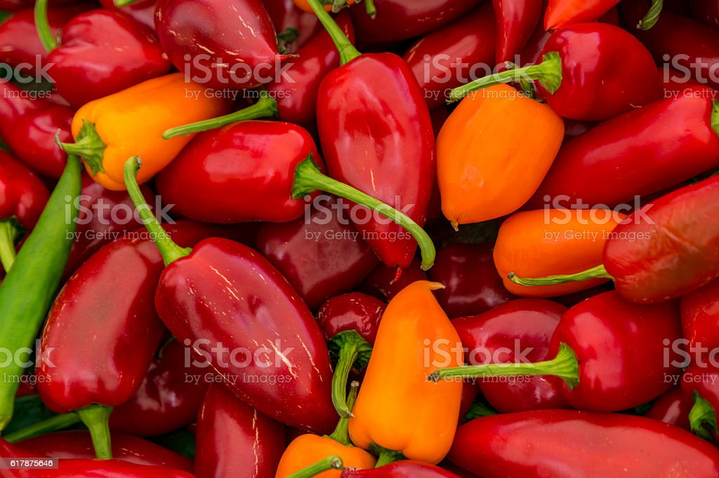 Red and Yellow Poblano Peppers For Sale stock photo