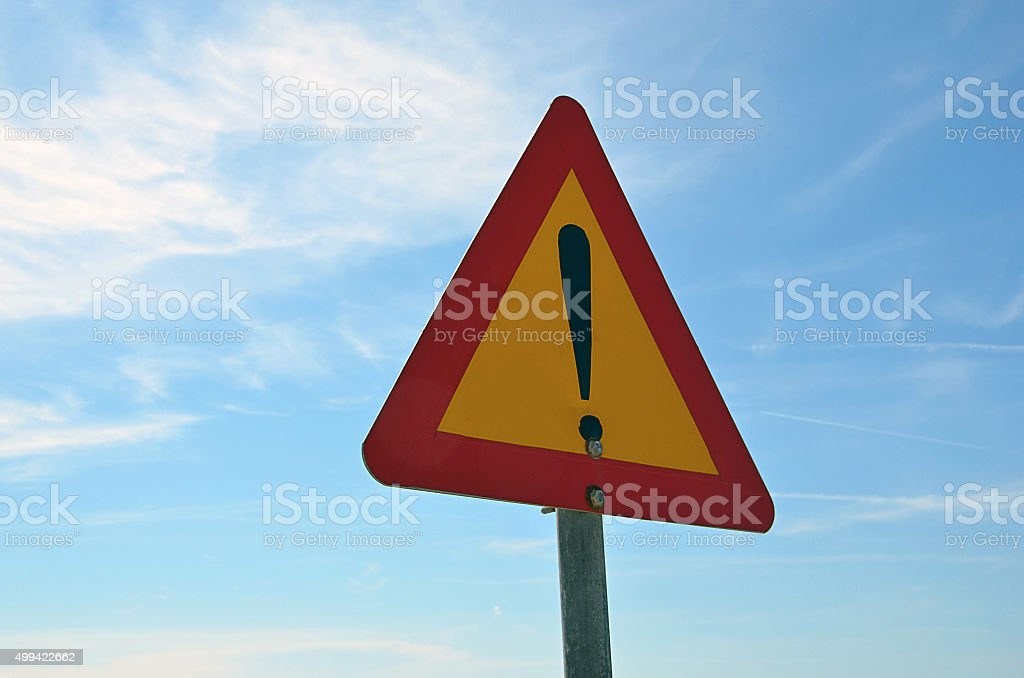 red and yellow road warning sign photography stock photo