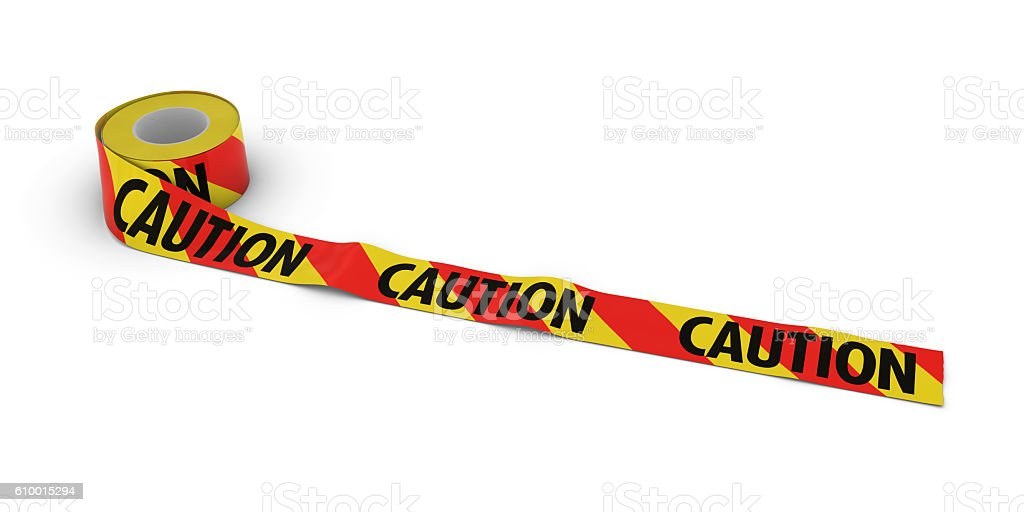 Red and Yellow Striped CAUTION Tape Roll unrolled across floor stock photo