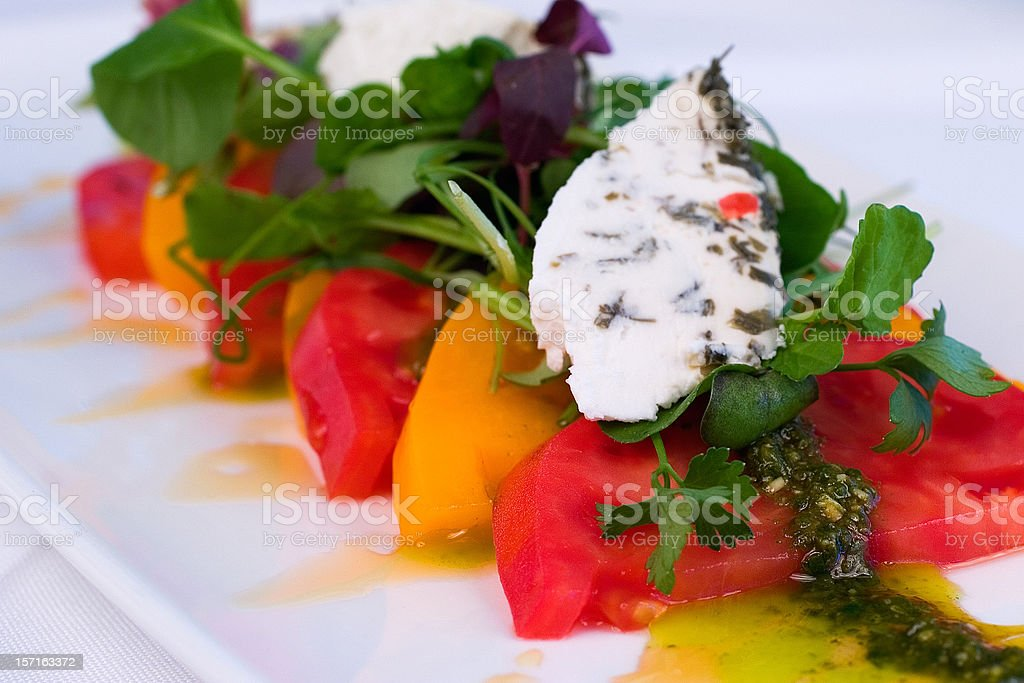 Red and Yellow Tomato Salad stock photo