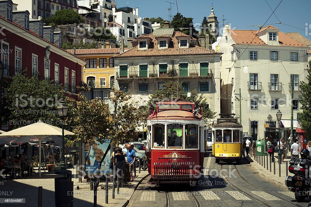 Red and yellow tram in Alfama, Lisbon stock photo