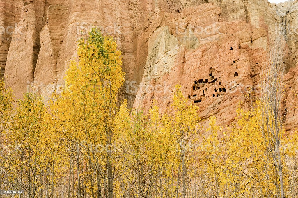 Red and yellow troglodyte dwellings in Dahkmar, Mustang stock photo