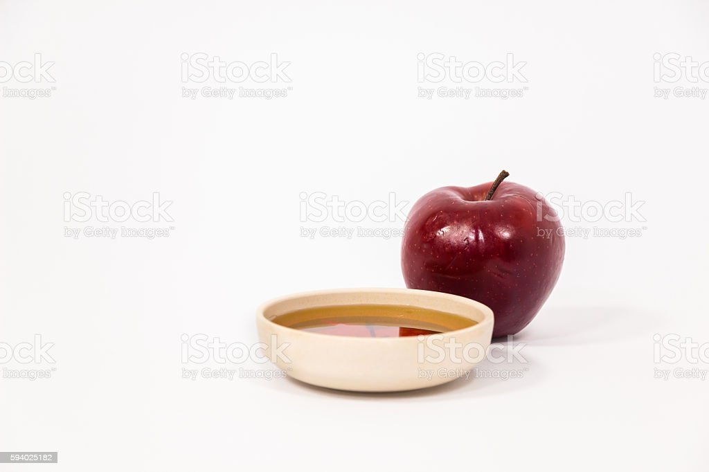 Red apple and bowl of honey isolated on a white stock photo