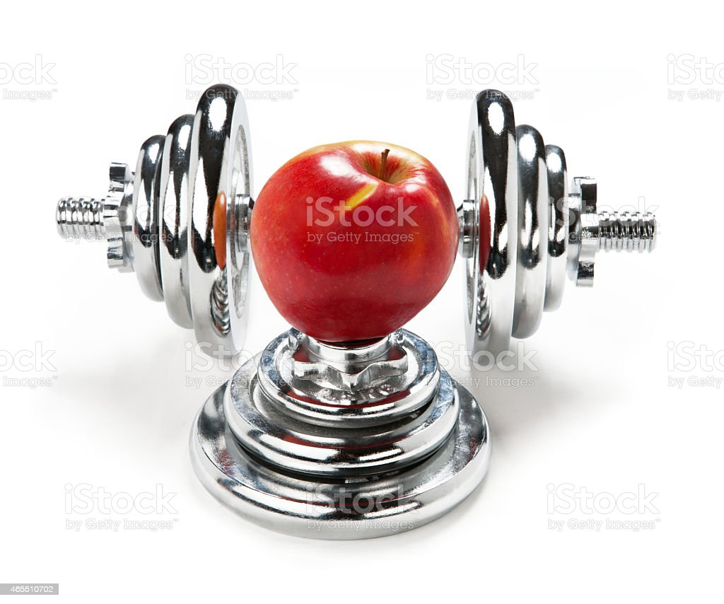 Red apple and dumbbell stock photo