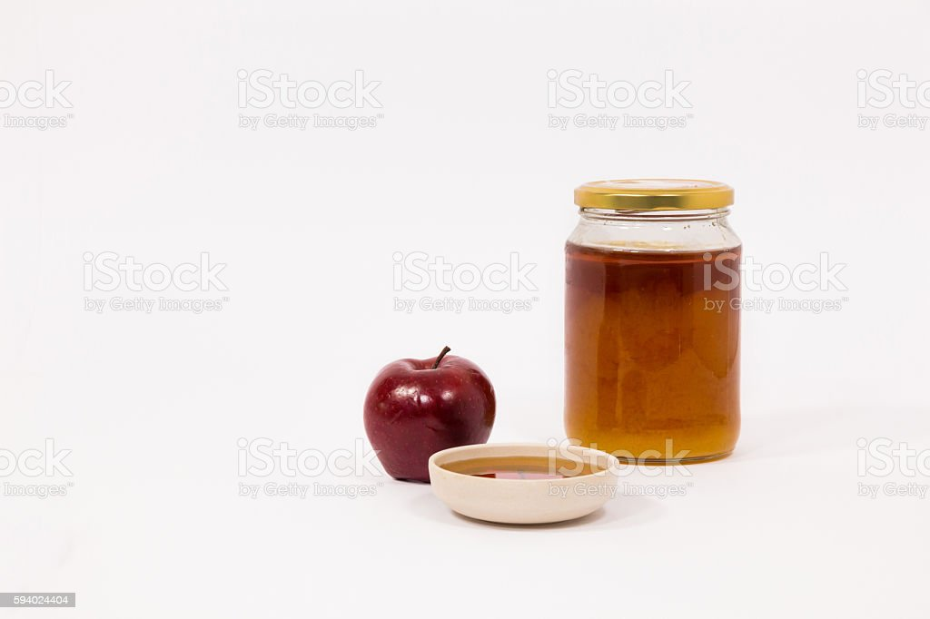 Red apple and jar of honey and bowl of honey stock photo
