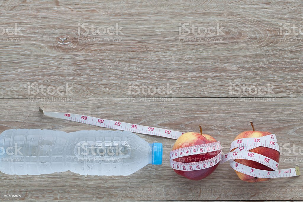 Red apple  and measuring tape.The concept of weight control Lose stock photo