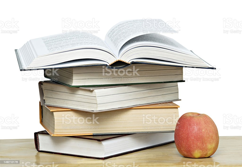 Red apple and open book on desk royalty-free stock photo