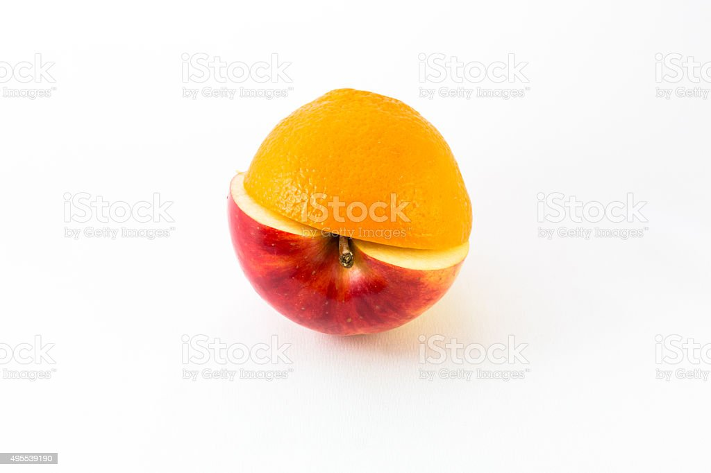red apple and orange half isolated. stock photo
