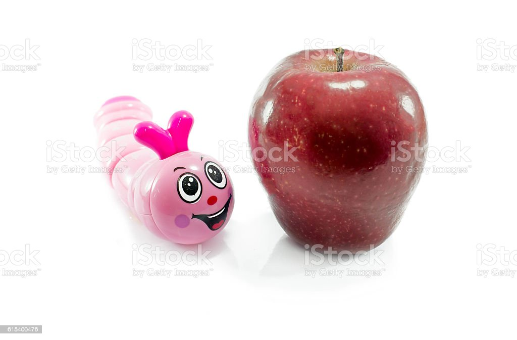 red apple and pink worm toy stock photo