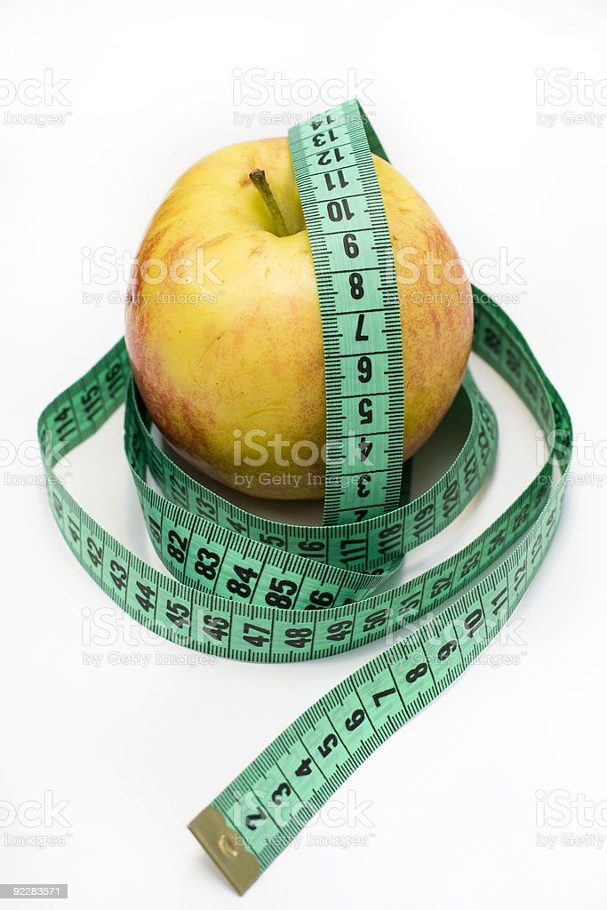 Red apple and tape measure royalty-free stock photo