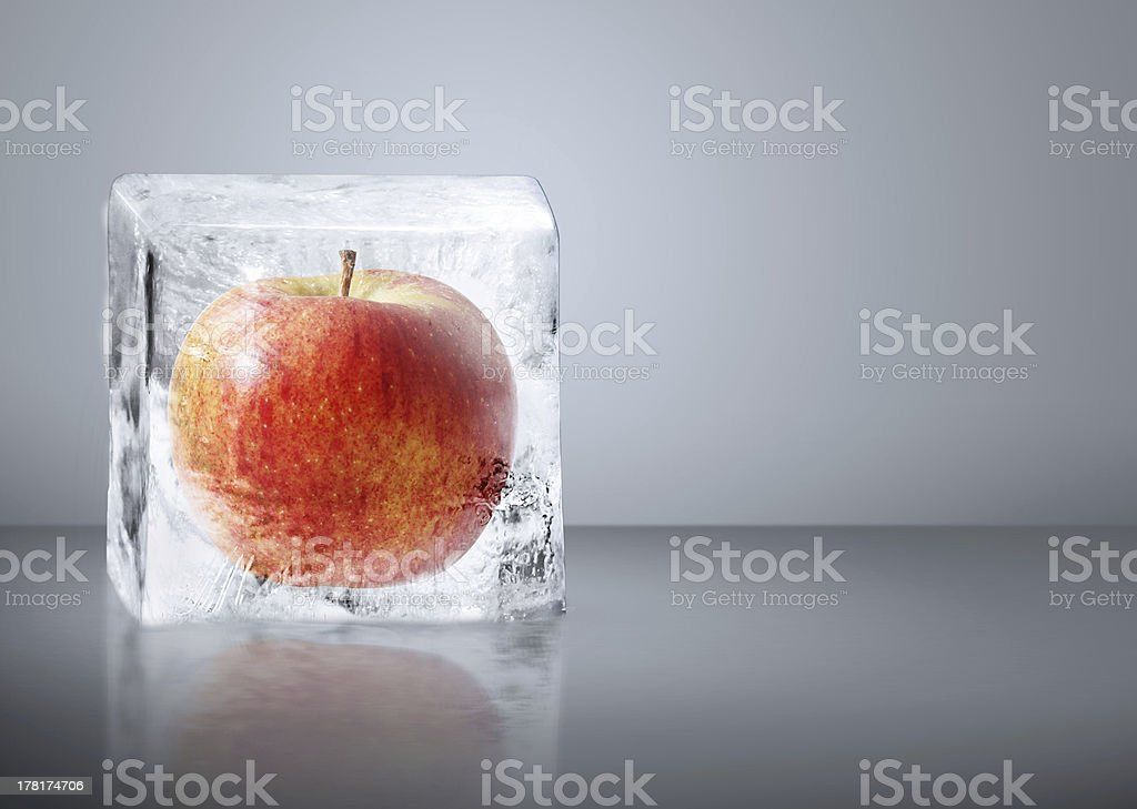 Red Apple frozen inside big ice royalty-free stock photo