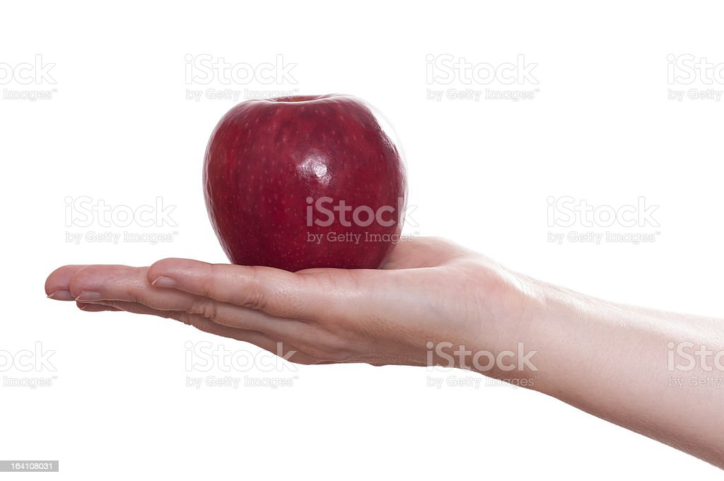 Red apple in a female hand royalty-free stock photo