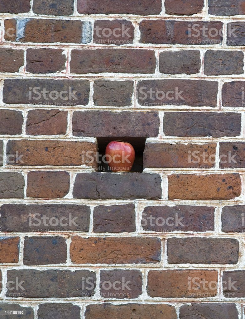 Red apple in brick wall royalty-free stock photo