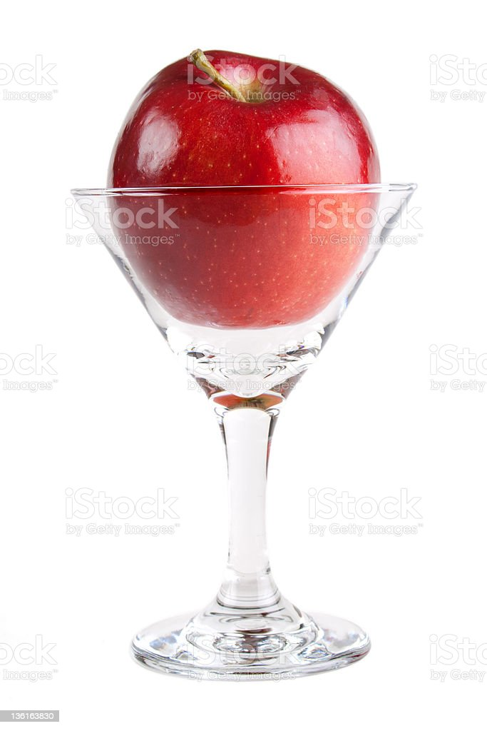 Red apple in cocktail glass royalty-free stock photo