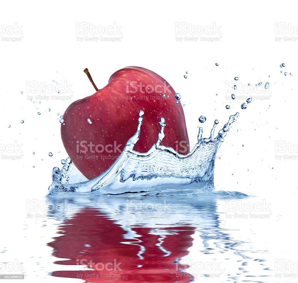 Red apple in splash royalty-free stock photo