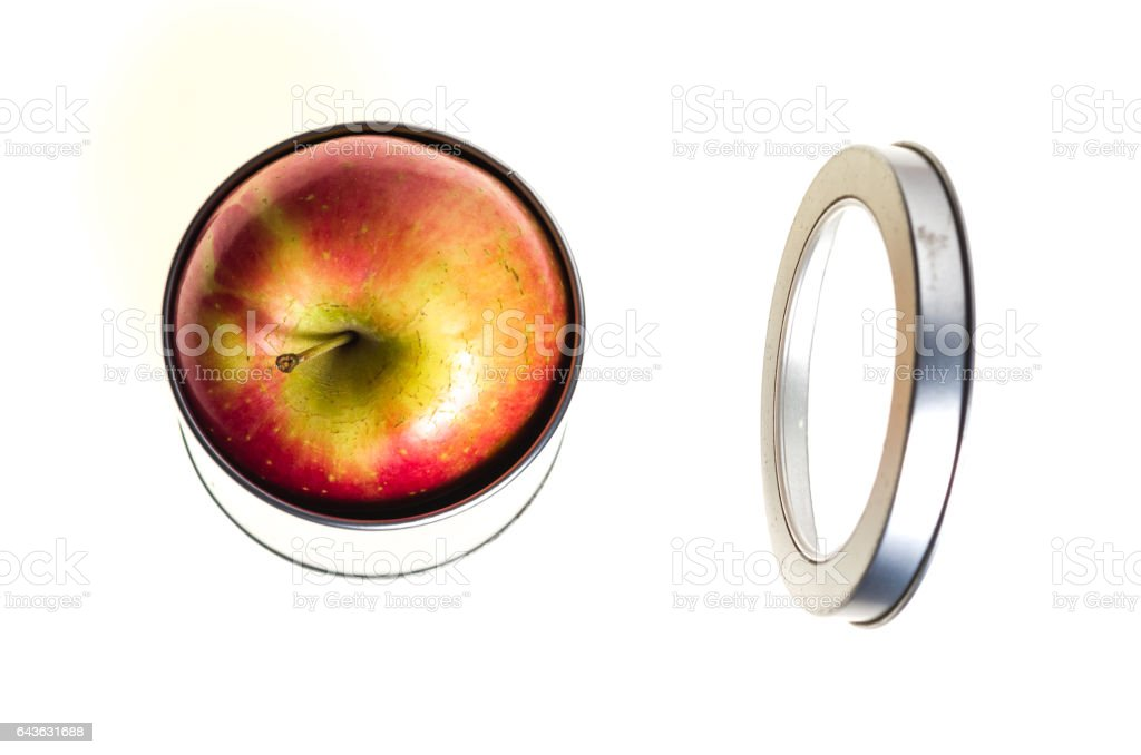 Red Apple Inside a Tin Can stock photo