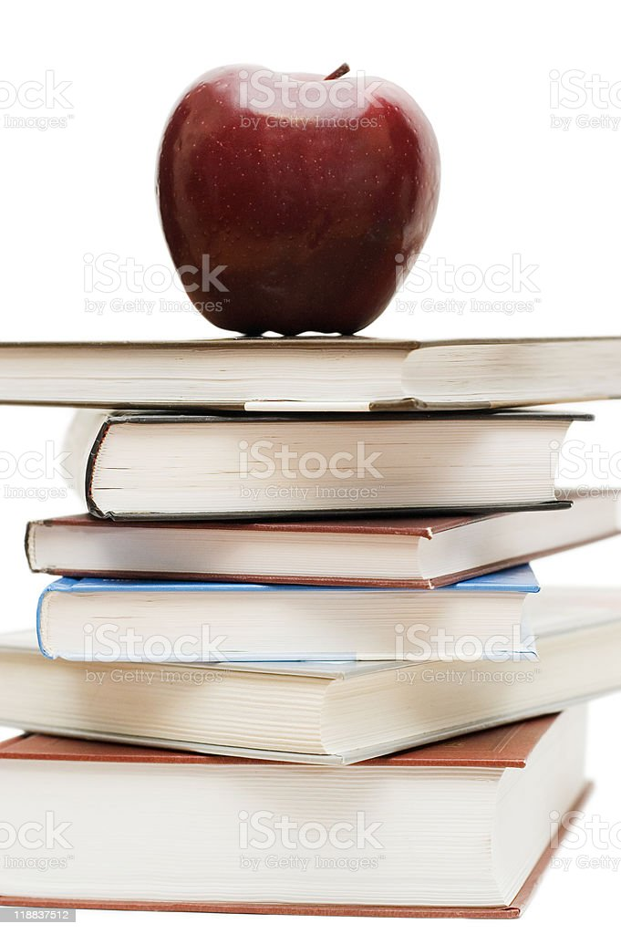 Red apple on a pile of books stock photo