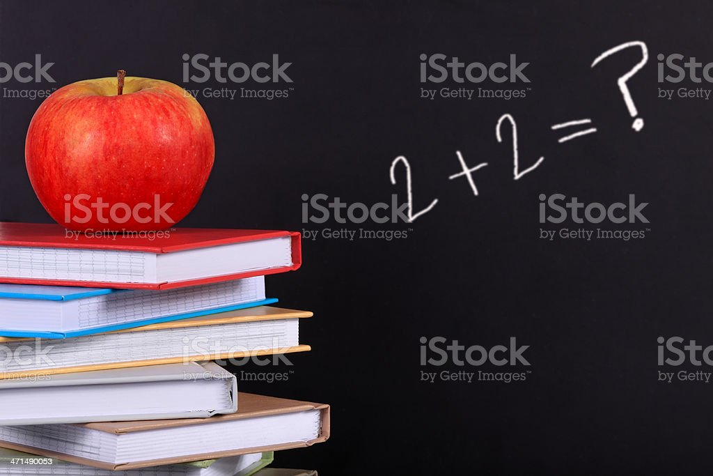 Red Apple on a Stack of Coloured Books royalty-free stock photo