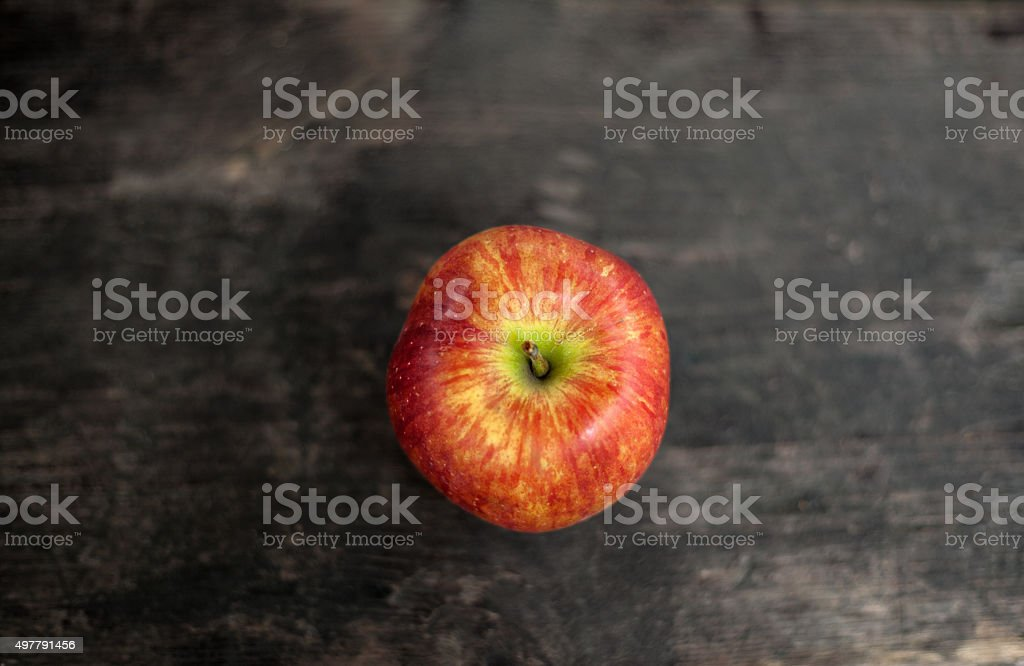 Red apple on a wooden table royalty-free stock photo