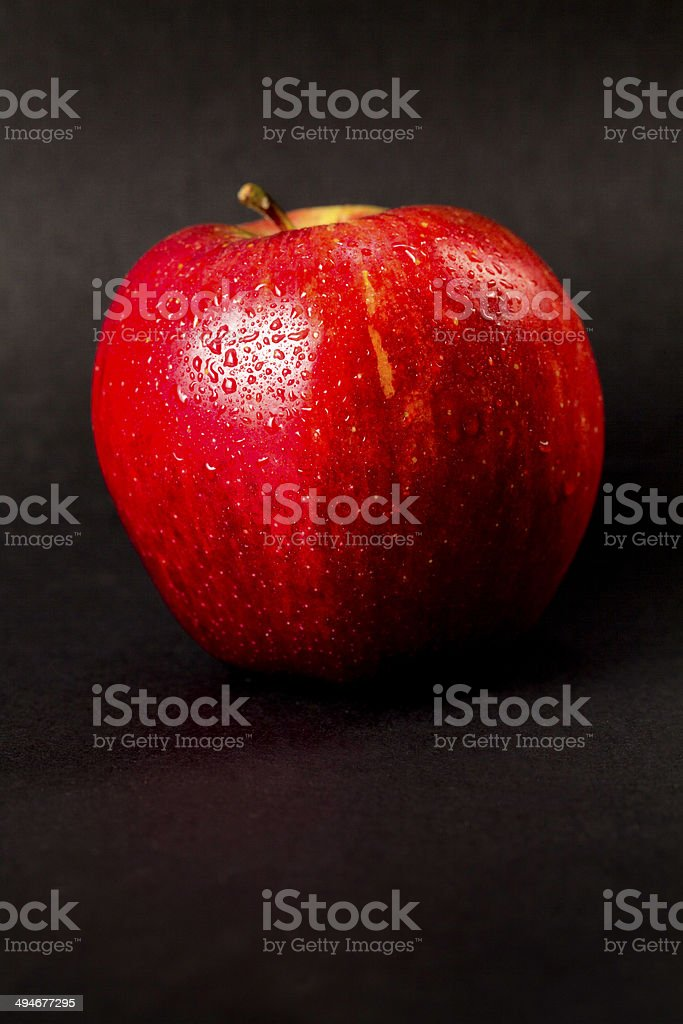 Red apple on black backgound royalty-free stock photo