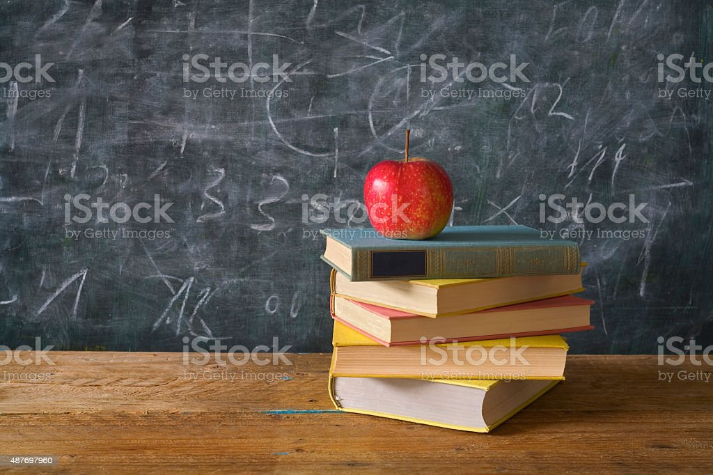 red apple on books with chalk board stock photo
