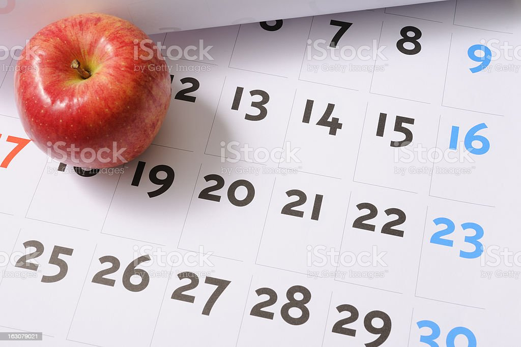 Red apple on calendar royalty-free stock photo