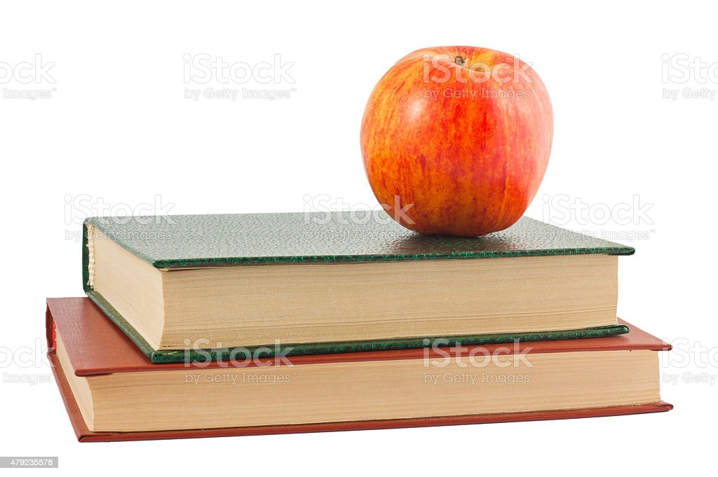 Red apple on the books stock photo