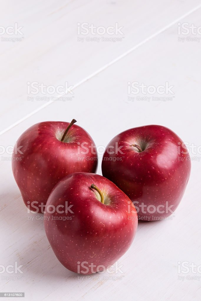 red apple on white table stock photo