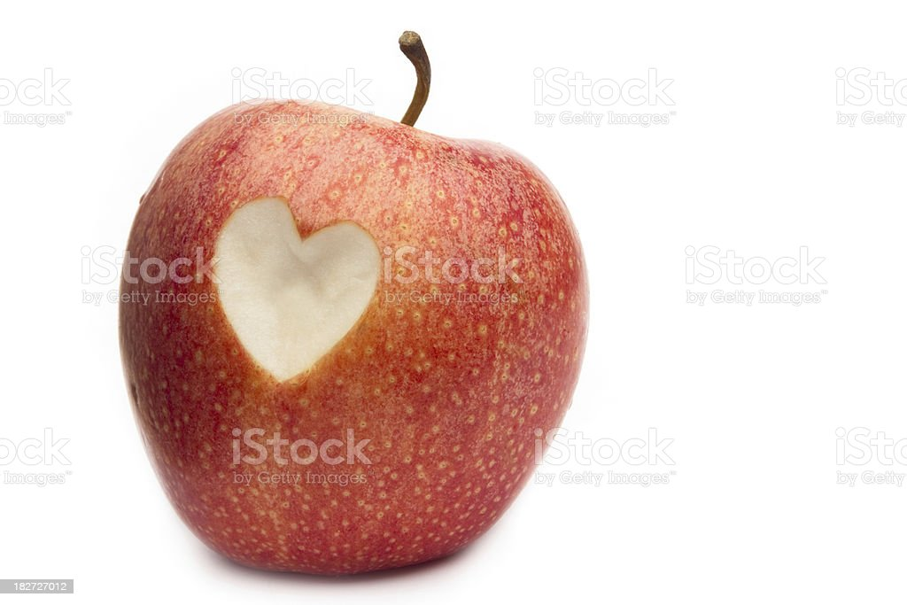 Red apple with a heart symbol royalty-free stock photo