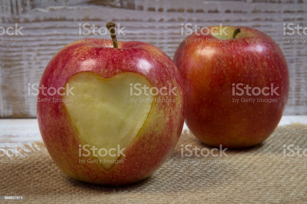 Red apple with carved heart stock photo