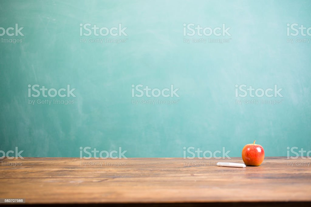 Red apple with chalk and school chalkboard. stock photo