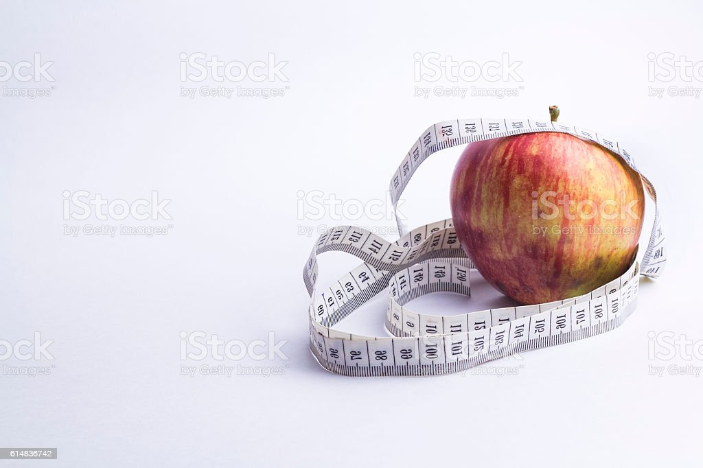 Red apple with measuring tape isolated on white stock photo