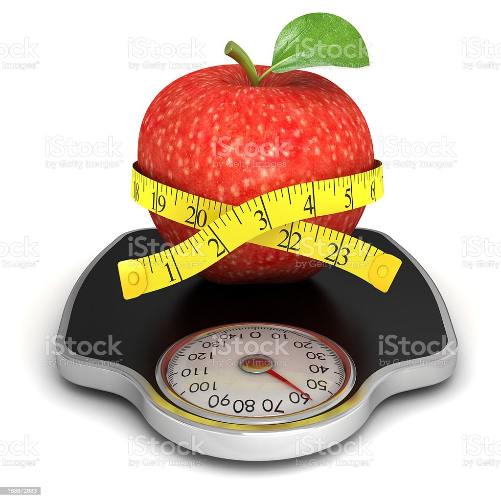 Red apple with measuring tape on the scales stock photo