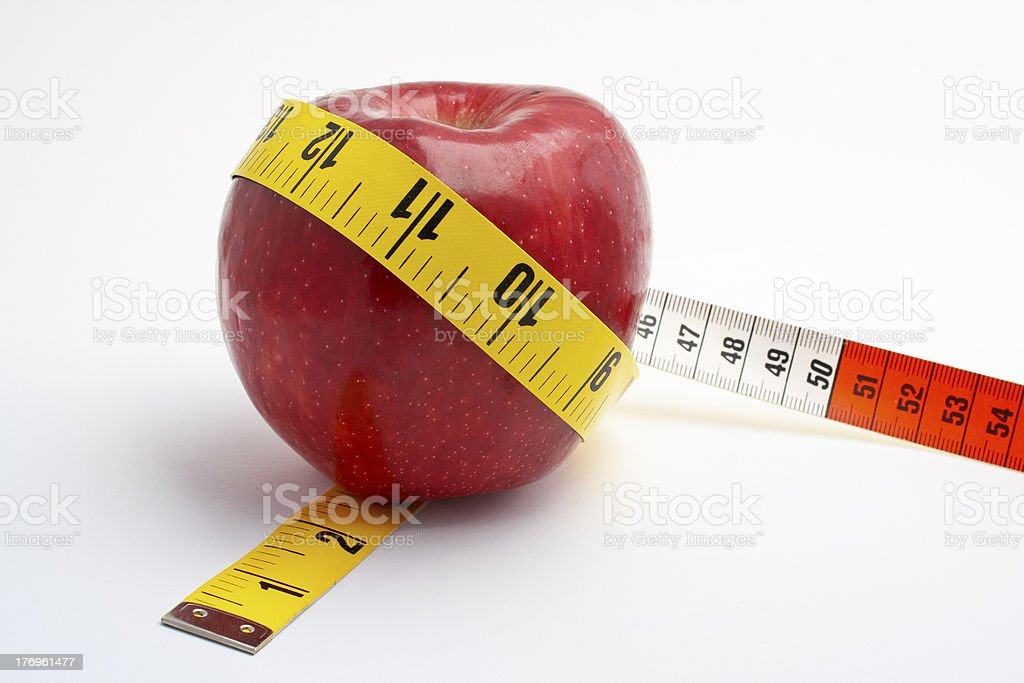 Red Apple with tape measure royalty-free stock photo