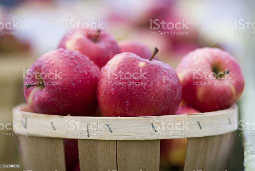 Red apple with waterdrops in the basket stock photo