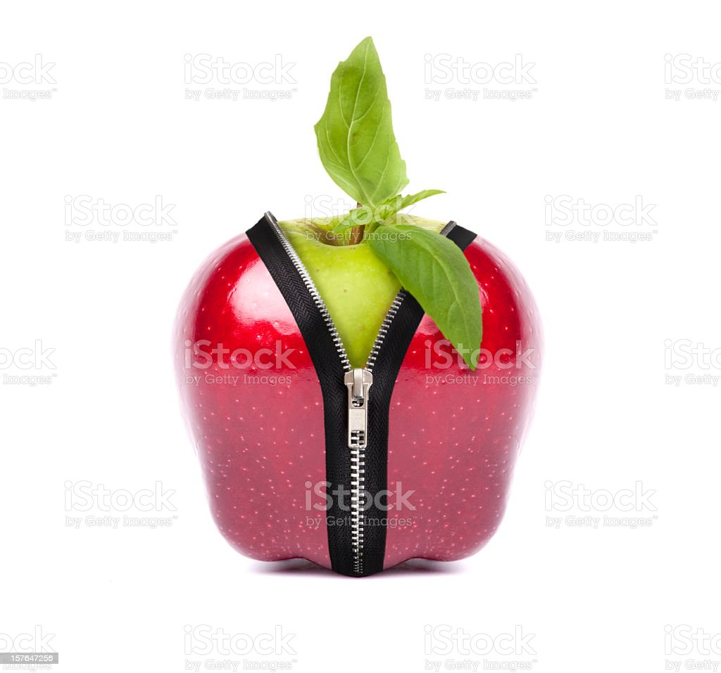 Red apple zipping Ito green apple stock photo