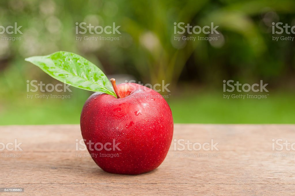 Red appleon wooden, Natural background stock photo