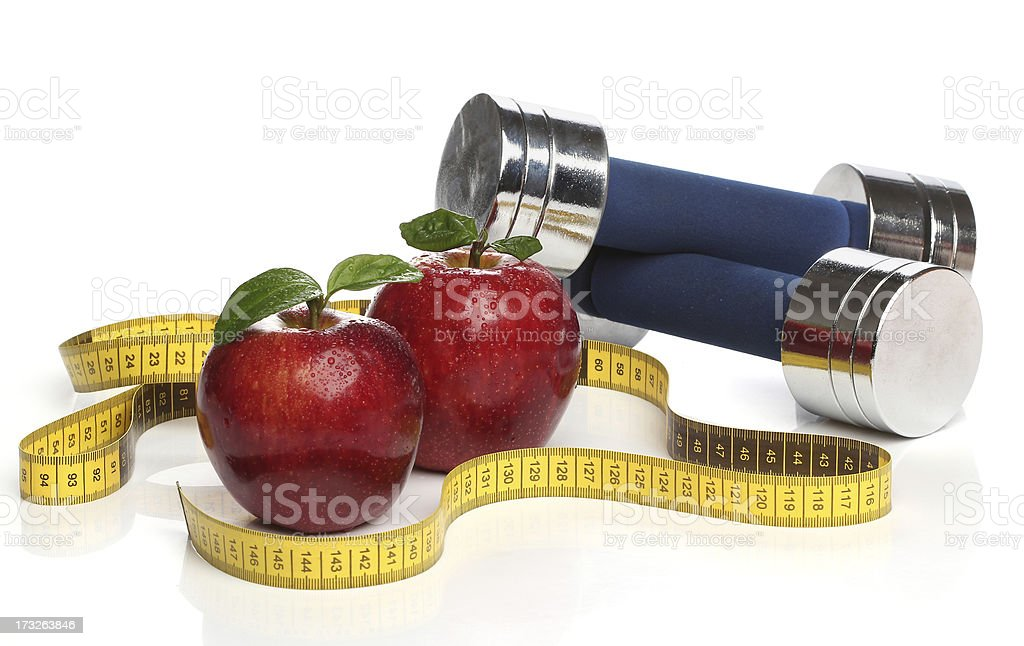 Red apples and a measuring tape over white royalty-free stock photo
