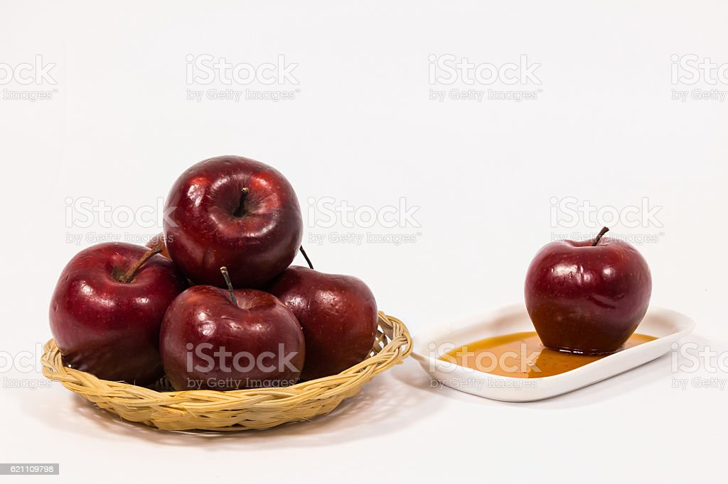 Red apples and red apple on plate with honey stock photo