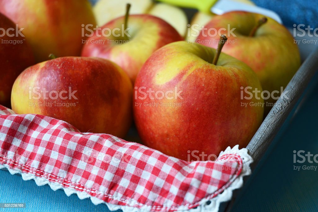 red apples in a fruit bowl decorated farm style stock photo