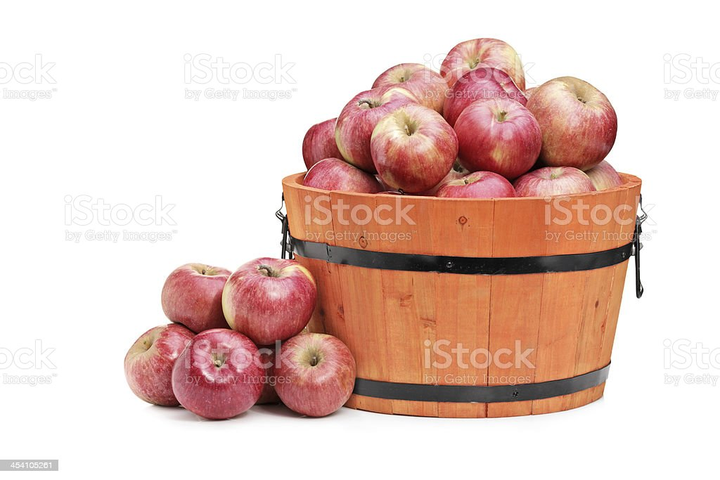 Red apples in a wooden bucket royalty-free stock photo